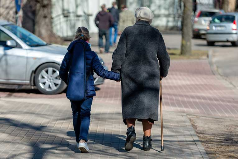 grandmother and grand-daughter holding hands and walking