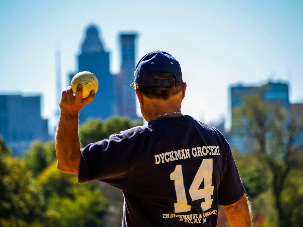 older man throwing a baseball, a form of baseball therapy
