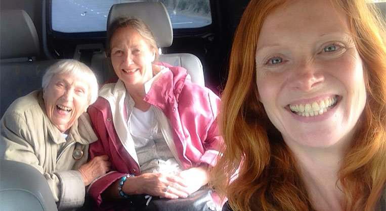 Photo: older woman with daughter and grandaughter in care