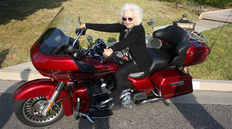 older woman on a motorcycle