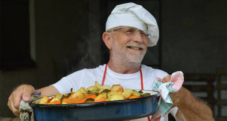 man in chef hat with veggies