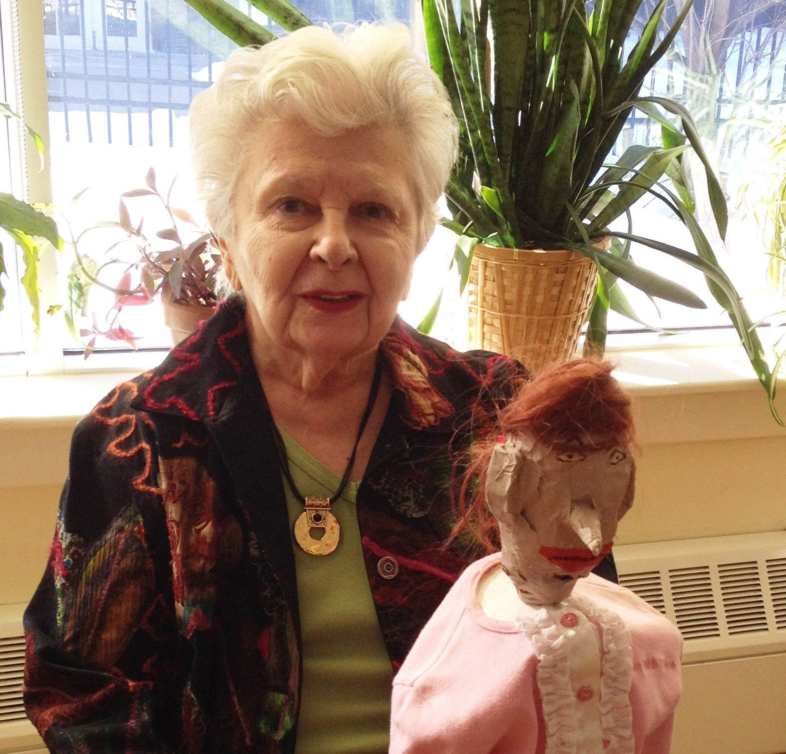 senior woman with puppet