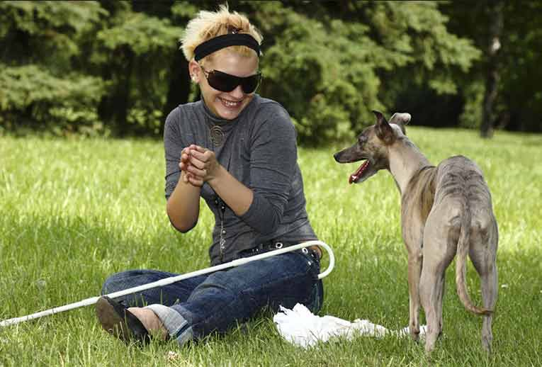 blind woman with a dog