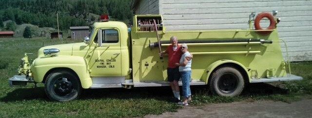 Bob and wife in front of a truck
