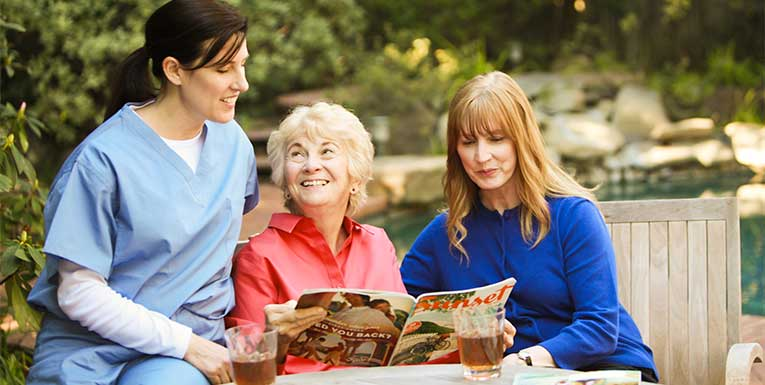 caregiver with senior and adult daughter