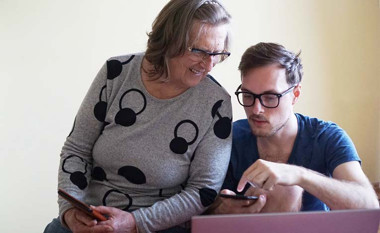 grandson and grandmother with technology