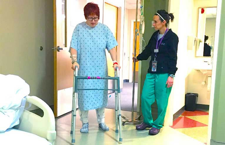 woman learning to walk again after hip replacement