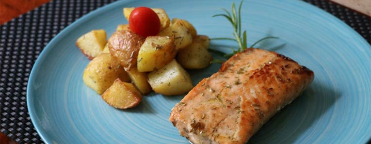 salmon and potatoes on blue plate